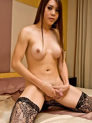Ladyboy Lusi In A Black Corset And Lacy Stockings