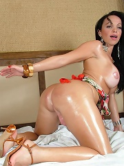 Thick Oiled Up Shecock Gets A Handjob From A Steamy Brunette Shemale